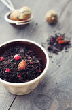 Dry tea with dried berries Stock Images