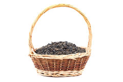 Dry tea leaves in a basket Stock Photos