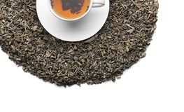 Dry tea leaves and cup with hot beverage on white background, top view stock photography