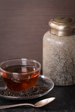 Dry tea leaves in glass cup of tea and vintage jar Royalty Free Stock Images