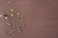 Dry tea leaves and herbal on a brown background stock images