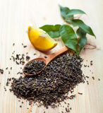 Dry tea leaves  and lemon Stock Photos