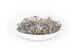 Dry tea leaves. Dry tea in plate in white background Royalty Free Stock Image