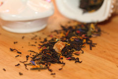 Dry tea. The scattered tea leaves of fragrant tea on a chopping board Royalty Free Stock Images