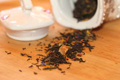 Dry tea. The scattered tea leaves of fragrant tea on a chopping board Stock Photography