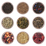 Dry tea sorts. Assortment of dry tea in ceramic bowls isolated on white Stock Photos