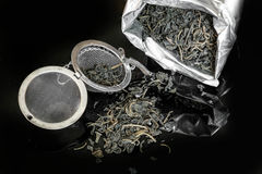 Dry tea and strainer, preparing for brew up Stock Photos