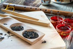 Dry tea variation in wooden box with tea tray Stock Image