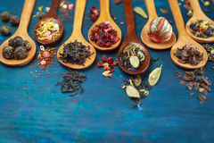 Dry tea with in wooden spoons Stock Images