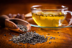 Dry tea on wooden table. Dry green tea on wooden table Stock Images