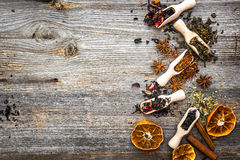 Dry teas on wooden background Stock Photography