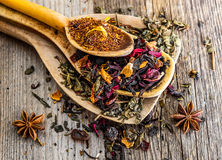 Dry teas in wooden spoons Royalty Free Stock Photography