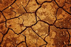 Cracked clay ground into the dry season. Dry, texture, crack, land, ground, desert, earth, sand dirt background drought mud arid pattern brown environment Royalty Free Stock Photography