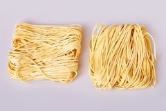 Dry thin rolled noodles square shape. Capelli d`angelo, Angel`s hair - pasta. royalty free stock photo