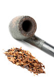 Dry tobacco and pipe Stock Photos