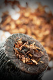 Dry tobacco and pipe Stock Photo