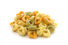 Dry tortellini tricolore. In isolated white Stock Photography