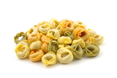 Dry tortellini tricolore. In isolated white Stock Images