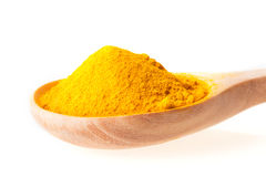 dry turmeric powder in wooden spoon on white background Royalty Free Stock Photography