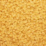 Dry uncooked macaroni texture background Stock Image