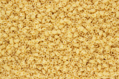 Dry uncooked rigatoni pasta texture background Stock Photo