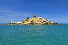 Dry uninhabited island and blue sky Royalty Free Stock Photography