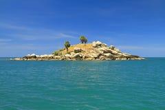 Dry uninhabited island and blue sky Royalty Free Stock Photography