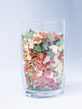 Dry vegetables in a glass. A glass with pieces of vegetables royalty free stock photography
