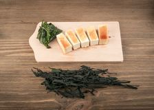Dry Wakame Seaweed. On Natural Wooden Background. Healthy Algae Food with Soy Sauce and Tofu Royalty Free Stock Image