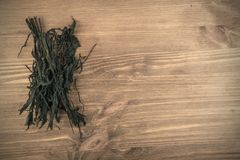 Dry Wakame Seaweed. On Natural Wooden Background. Healthy Algae Food Stock Image