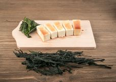 Dry Wakame Seaweed. On Natural Wooden Background. Healthy Algae Food with Soy Sauce and Tofu Royalty Free Stock Images