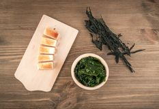 Dry Wakame Seaweed. On Natural Wooden Background. Healthy Algae Food with Soy Sauce and Tofu Top View Stock Photography