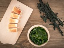 Dry Wakame Seaweed. On Natural Wooden Background. Healthy Algae Food with Soy Sauce and Tofu Top View Royalty Free Stock Photography
