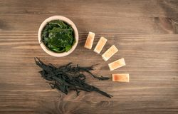 Dry Wakame Seaweed. On Natural Wooden Background. Healthy Algae Food with Soy Sauce and Tofu Top View Royalty Free Stock Image