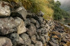 Dry-Wall on a trek along the Naerofjord in Norway -2 Stock Photo