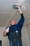 Dry waller making ceiling stock photo