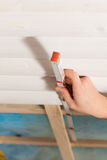 Dry waller with measuring with folding rule. Man doing dry walling, working with a folding rule Stock Photo