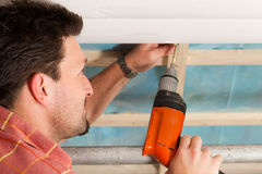 Free Dry Waller With Cordless Screwdriver Royalty Free Stock Photo - 20445865