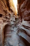 Dry wash in a narrow, undulating slot canyon