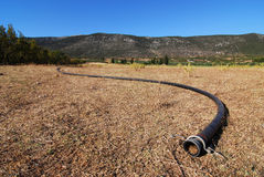 Dry water pipe. Drought implied with dry water pipe on dry farmland Stock Photo