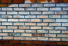 Brick stone texture of wet bricks on the wall. Dry and wet bricks on the wall of the house royalty free stock photos