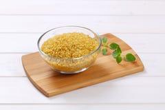 Dry wheat bulgur Stock Images