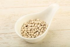 White beans. Dry white beans in the bowl over wooden background Stock Image