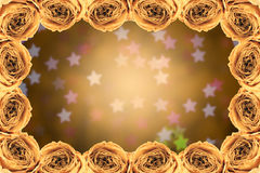 Dry white rose frame on blur star bokeh. Beautiful dry white rose frame on blur star bokeh background Royalty Free Stock Photography