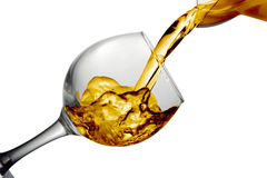 Dry white wine is poured into a glass Royalty Free Stock Image