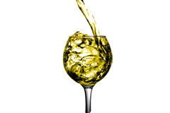 Dry white wine is poured into a glass. Dark Orange liquid, water, apple juice, white wine pouring into a glass, liquid in a speaker, isolated on a white Royalty Free Stock Image