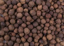 Dry whole allspice, jamaica peppe. Texture background royalty free stock images