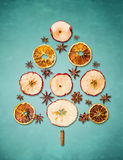 Dry winter fruits christmas tree on blue background Stock Image