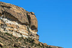 Dry winter orange colored rocky mountain and blue sky landscape in the Orange Free State in South Africa Stock Photo