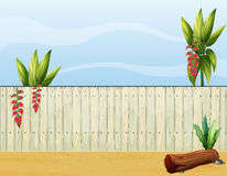 A dry wood piece and a fence. Illustration of a dry wood piece and a fence Royalty Free Stock Photo